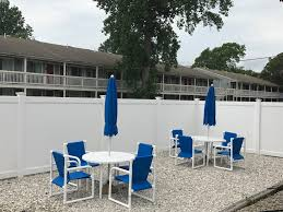 outdoor pool seating at town n country family resort cape cod
