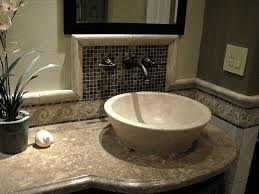 classic travertine sink bowls rest on top of the custom made