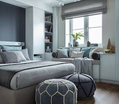 blue grey bedroom with off white woven area rug bedroom