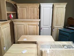 how to paint particle board cabinets pantries and cabinets galore carrell s unfinished furniture