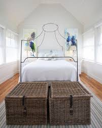 italian canopy bed lovely cottage bedroom features shiplap walls and ceiling over an