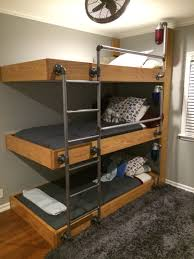 the bunk beds my engineer husband designed for our three Three Person Bunk Bed