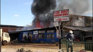 fire burns down city shop youtube