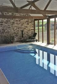 grand luxurious outdoor swimming pool design presenting blue water