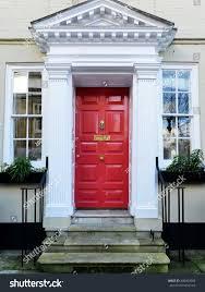 red front door red front door attractive old london stock photo 490409566