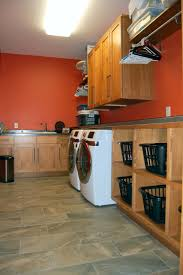 laundry rooms yoder cabinets wherever your laundry is located in a basement in a closet upstairs or down in a tiny space in the garage yoder s cabinets can make it a unique