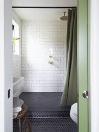 small bathroom with black hexagon bathroom floor tile and marble