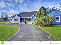 beautiful blue rambler house with tile roof stock photo image