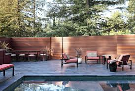 horizontal wooden backyard fence ideas mixed with wooden furniture