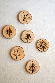 burn on wood tree branch ornaments wood burned trees and snowflakes