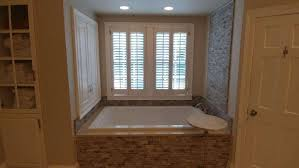 travertine walls travertine accent walls in master bathroom giovanni s tile design