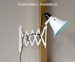 remodelaholic diy accordion wall lamps from 5 ikea mirrors