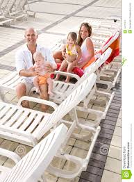 family vacation relax on pool deck lounge chairs stock image