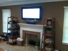 mounting tv over gas fireplace wall mount plasma install support how high hang fireplace mounting over