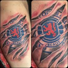 ripped skin awesome football team logo tattoo golfian com