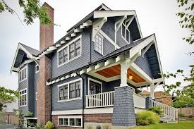 all american blue craftsman home with black windows and white