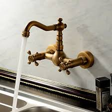 kitchen wall faucet antique inspired kitchen faucet wall mount antique brass finish