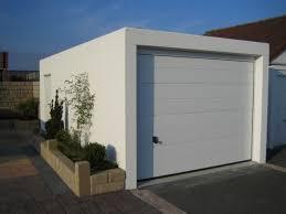 cool modern white prefab garage design idea white rolling metal cool modern white prefab garage design idea white rolling metal door