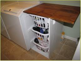 Laundry Room Storage Shelves by Interior Brown Wooden Laundry Pull Down Table On Basket Shelf
