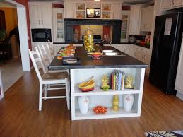 kitchen black kitchen island with large seating and storage in