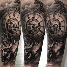 black and grey pocket watch tattoo on the inner