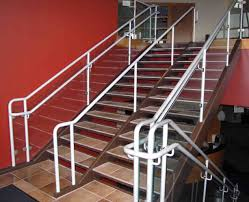 tile tread staircase with aluminum hand rail and glass panels