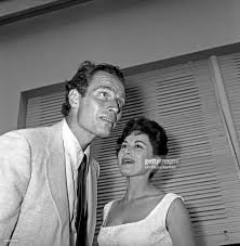 charlton heston and his wife lydia clarke at the cocktail party
