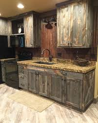 Refurbished Kitchen Cabinets A Little Barnwood Kitchen Cabinets And Corrugated Steel Backsplash