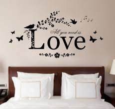 interior astounding wall art decor sticker ideas wall art decor fascinating wall art decor brown wooden headboard white pillows white bed linen white bedspread