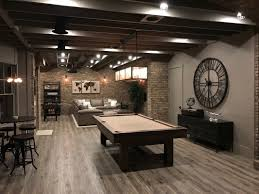 nicely finished basement with painted exposed ceiling finished