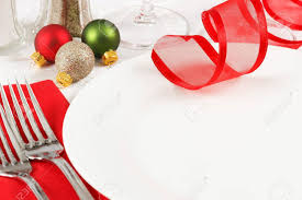 ornaments decorate a restaurant table setting in festive