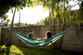 decorating green brazilian hammock with crocheted trim for