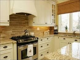 Cream Subway Tile Backsplash by Backsplash Colors For Kitchens Using White Carrara Marble And