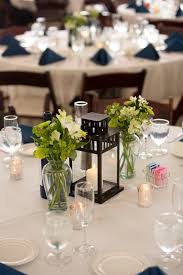 wedding centerpieces with lanterns and flowers candle and lantern