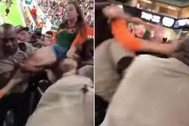 miami fan slaps officer slapped cop throws devastating punch at female football fan