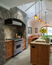 art craft combine in an east memphis stunner a wide stone surround makes a statement in the kitchen which features a butcher block
