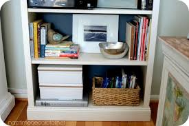 Billy Bookcase Makeover Styling Bookcases For A Much Used Family Room Mixing Pretty And