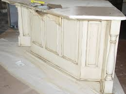 wood countertops distressed white kitchen cabinets lighting