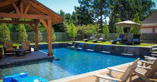 wonderful backyard patio with wooden pool lounge chairs also arm