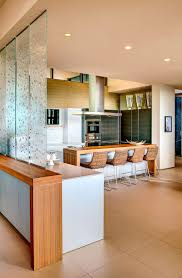 Glass Partition Between Living Room And Kitchen Mountain Home With Scenic Views By Kevin B Howard Architects