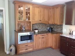 frameless glass kitchen cabinet doors hang modern nickel pendant lamps kitchen ideas black appliances