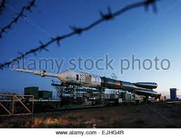 the soyuz tma 15m spacecraft is seen after the gantry arms closed