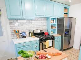 Kitchen With Red Appliances - open kitchen designed with red cabinets and ceramic flooring