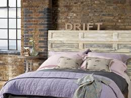 bedroom rustic bedroom ideas shag throw silver accents wall art full size of brick wall glass ewer round nightstand blur window blue blanket grey bed cover