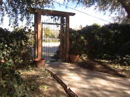 flagstone walkway and trellis gate hgtv