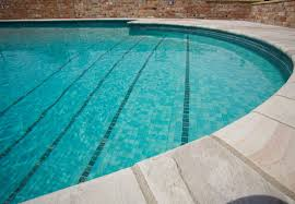 in ground swimming pool stone outdoor sussex oasthouse