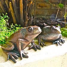 pair of frog garden sculptures by garden trading