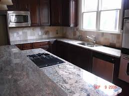 How To Install Kitchen Cabinet Doors Tropical Brown Granite With White Cabinets Thermofoil Kitchen