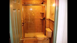 bathroom shower glass door and modern toilet with tile walls for