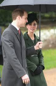 prince william shelters kate middleton with umbrella on walk to